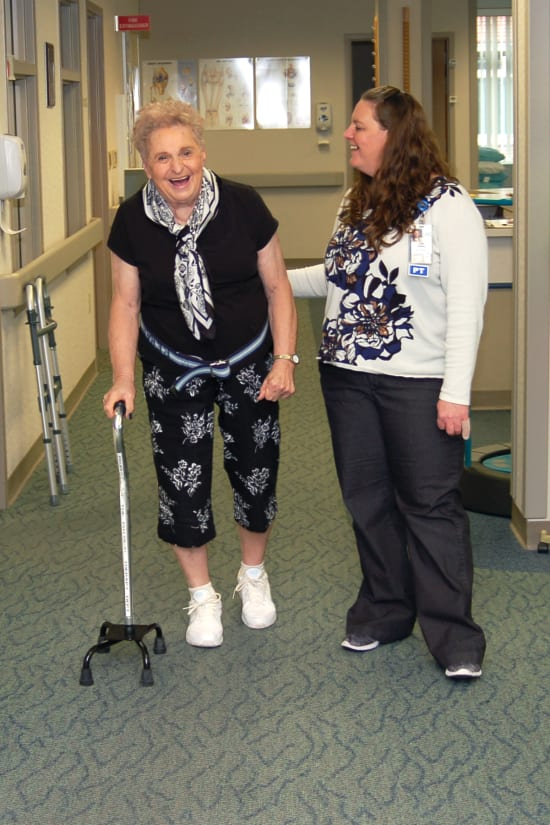 """Lois Shipp practices walking with a cane with Lake Regional Physical Therapist Assistant Ann Perry."""""""