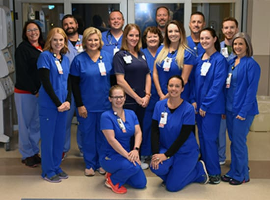 Pictured from Lake Regional Emergency Department are (front row) Brianne Luck, R.N., and Samantha Emery, R.N.; (middle row) Amy Funderburk, R.N.; Sherrie Williams, R.N., Vicki Preble, CNA; Kathleen Bybee, R.N.; Alexis Cooney, R.N.; Lacey Schmidt, R.N.; and Karen Ray, R.N.; and (back row) Meredith Leach, M.D.; Alex Miller, PCT; Kyle Davolt, R.N.; Todd Cooper, M.D.: Bruce Schlager, R.N.; and Jake Anderson, PCT.