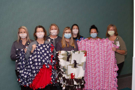 Lake Regional Health System Diagnostic Imaging staff pose with handmade blankets for Lake Regional Cancer Center patients. Pictured left to right are Katelynn Holdt, Anita Durfee, Jennifer Stadter, Casey Meier, Chastity Rapier, Courtney Upton and Linda Smith.