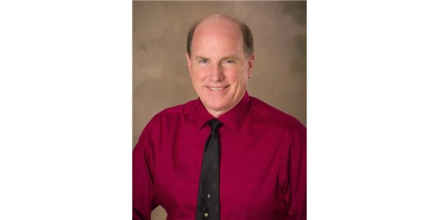 John C. Nicholson, MD