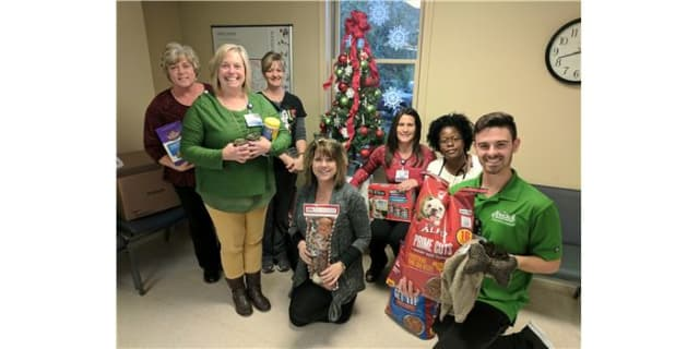 Staff in the Cardiopulmonary Rehabilitation department hold donations for the Iredell County Animal Shelter. (From Left to Right): Angela Little, Lisa Warren, Amy Henry, Valerie York, Angela Lanier, Lisa Tate, Jacob Cozart