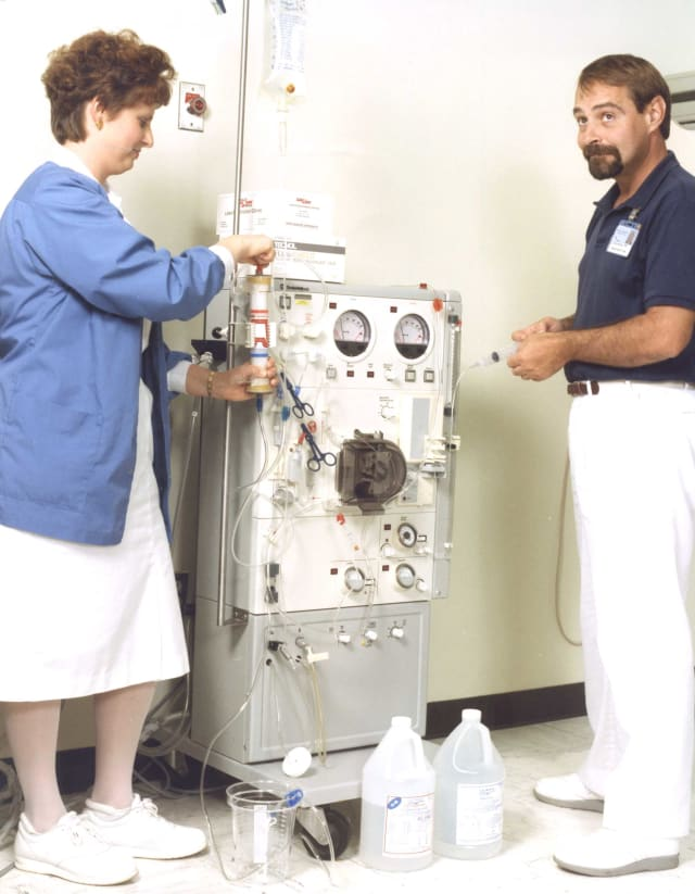 Steve Kivett, right, stands with Carol Zachary, RN, in the Dialysis Department in 1992. The two employees still work together in the Dialysis Department today.