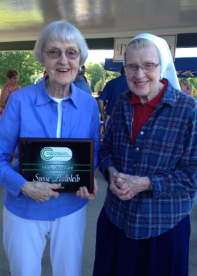 smiling woman holding award