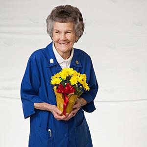 Lummie with Flowers | CarolinaEast Volunteer Program | New Bern, NC