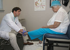 Doctor examining patient's ankle | Podiatry