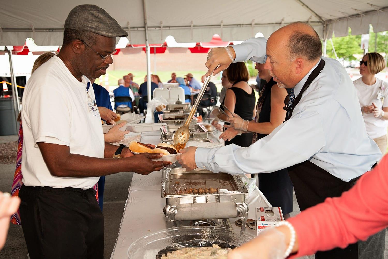 Volunteers Serving Food | CarolinaEast Volunteer Program | New Bern, NC