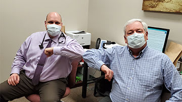 Brian Quick and Dr. Kenneth Valyo at Crossing Rivers Health Fennimore Clinic