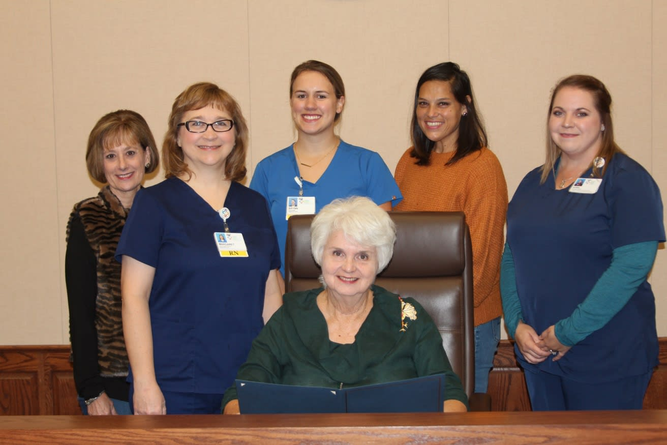 Cuero Home Health staff witness Sara Post Meyer, Mayor of the City of Cuero, signs a proclamation that recognizes November as Home Care Month.