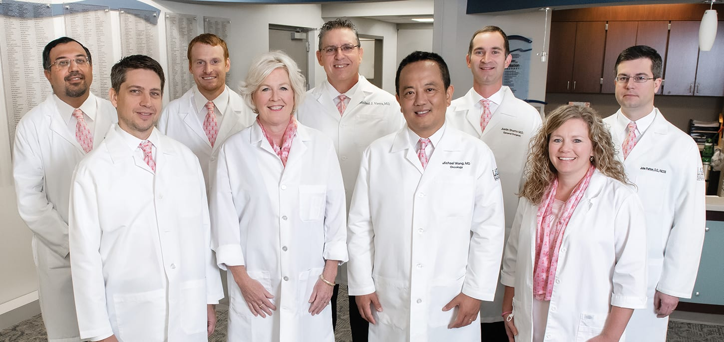 "Lake Regional's cancer team includes (front row) Radiation Oncologist Gregory Biedermann, M.D.; Oncologist Maggi Coplin, M.D.; Oncologist and Hematologist Michael Wang, M.D.; Advanced Oncology Certified Nurse Practitioner Brandi Kincaid, NP-C, AOCNP; (back row) Pulmonologist Harjyot ""Joe"" Sohal, M.D.; Urologist Eric McQueary, D.O.; Radiologist Michael Vierra, M.D.; General Surgeon Justin Shatto, M.D.; and General Surgeon John Patton, D.O., FACOS."