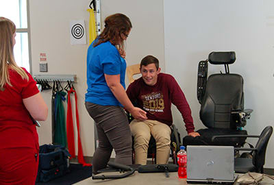 Hunter interacts with Katie Kelley, occupational therapist, and Meghan Stayton, occupational therapist assistant.