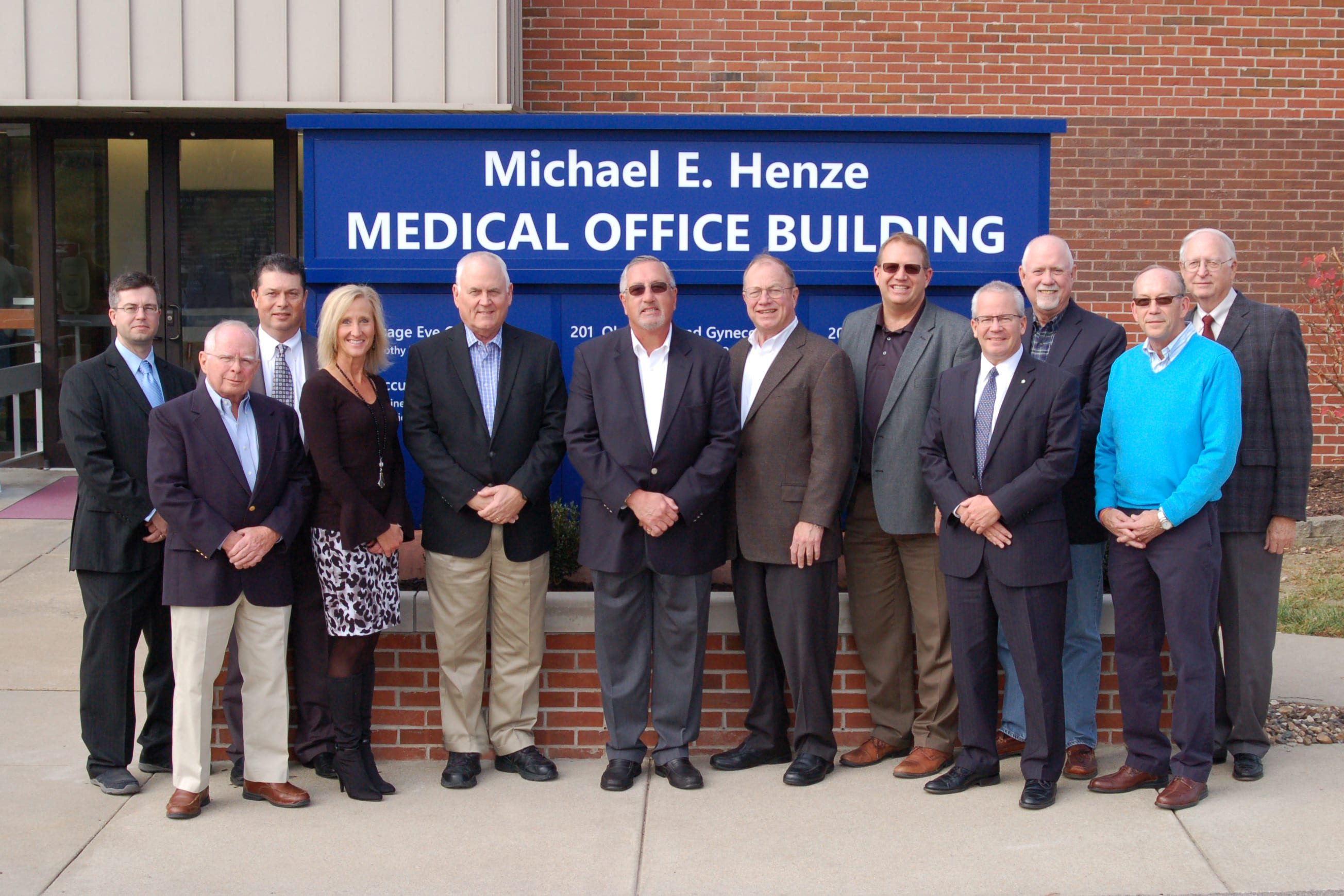 Michael E. Henze, center, stands with members of the Lake Regional Health System Board of Directors. Left to right are John Patton, D.O., FACOS; Larry Shields; Alan Mead, M.D.; Karen Faiferlick; Wayne Compton; Henze; Robert Schwendinger; Corey ten Bensel; James Judas; Charles McElyea; John Caine; and John Parrish.