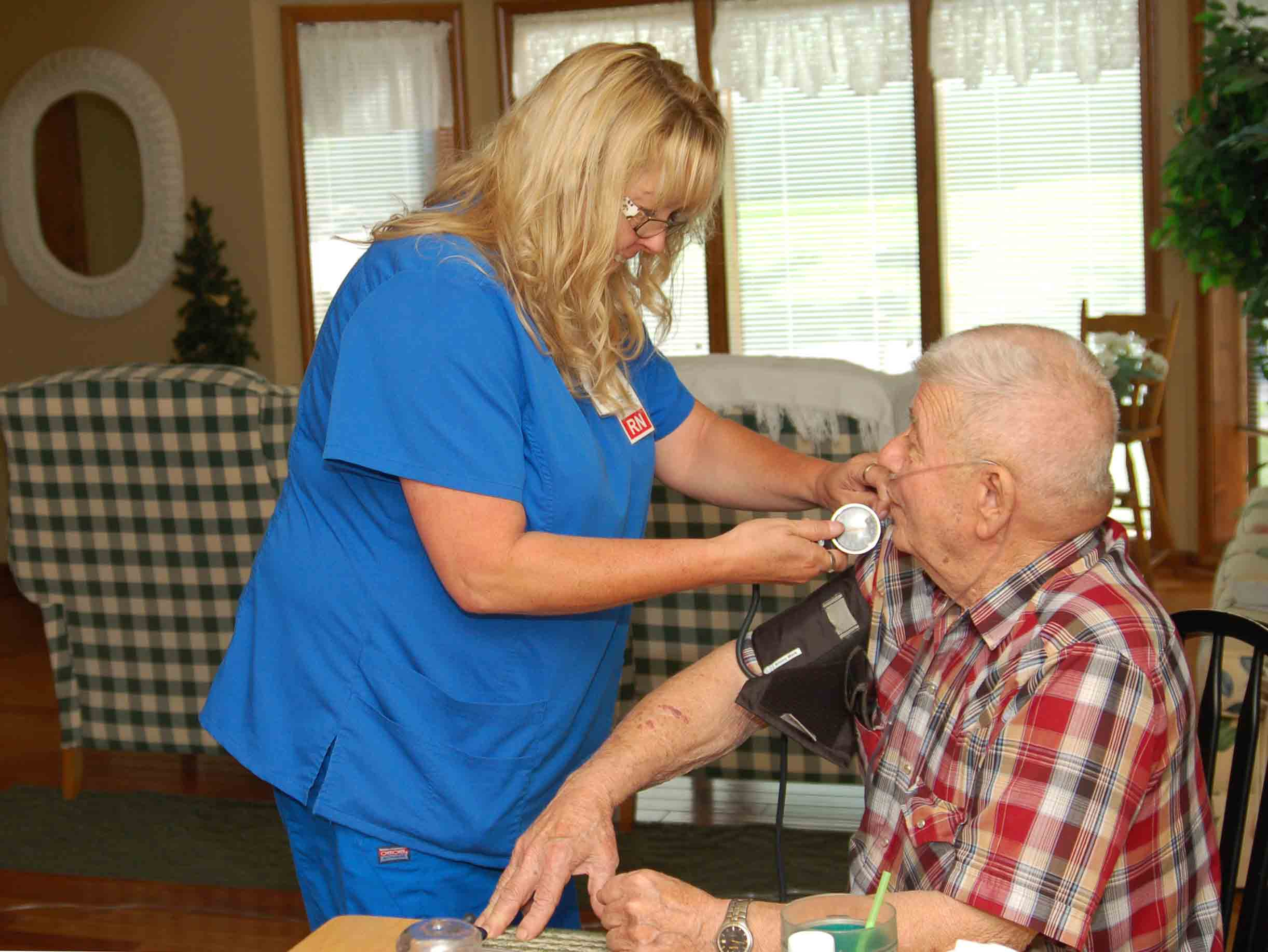 Lake Regional Nurse Toshia Melton checks hospice patient Donald Simpson's vitals during a home visit.