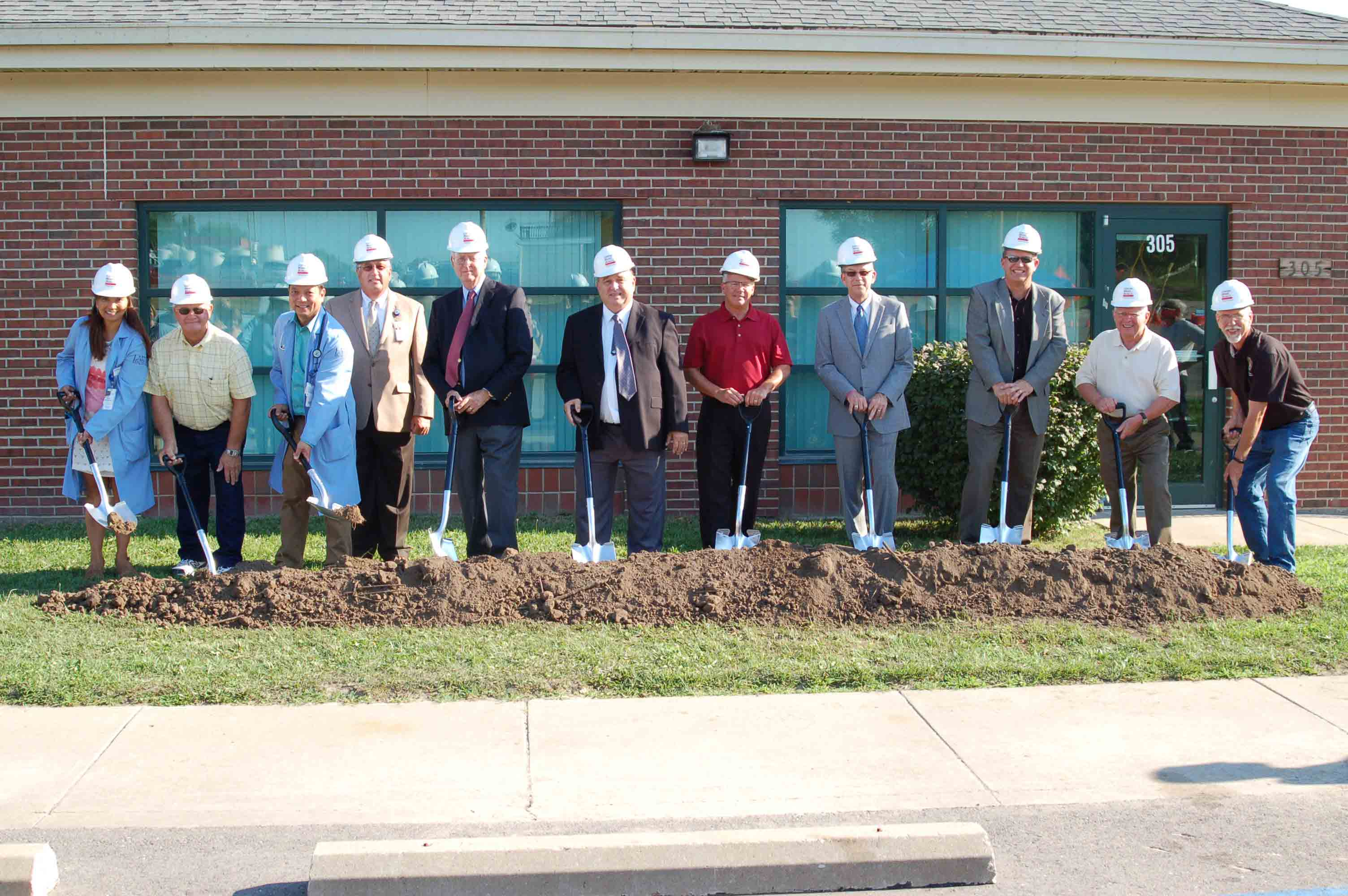 Lake Regional Health System held a groundbreaking Thursday, July 21, to celebrate the upcoming expansion of Lake Regional Clinic – Eldon. Pictured are Lake Regional Clinic – Eldon's Maria Bernabe, M.D., FAAP; Dan Schulte, Curtiss-Manes-Schulte president; Lake Regional Clinic – Eldon's Paul Bernabe, M.D., FAAFP; Michael E. Henze, Lake Regional CEO; John Parrish, Lake Regional board member; Eldon Mayor Larry Henderson; James Judas, Lake Regional board vice president; John Caine, Lake Regional board member; Corey ten Bensel, Lake Regional board president; Larry Shields, Lake Regional board member; and State Rep. David Wood.