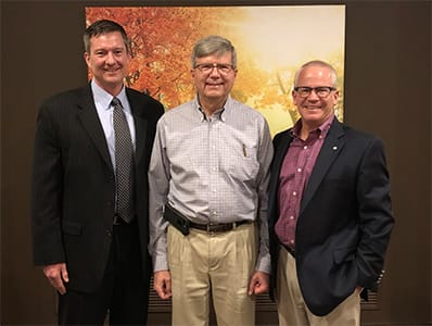 Grant Barnum, D.O., FACOI, center, is Lake Regional Health System's 2019 Physician of the Year. Congratulating him at the annual Doctors' Day banquet, held March 28, are Lake Regional CEO Dane W. Henry, FACHE, and Jim Judas, president of the Lake Regional Health System Board of Directors.