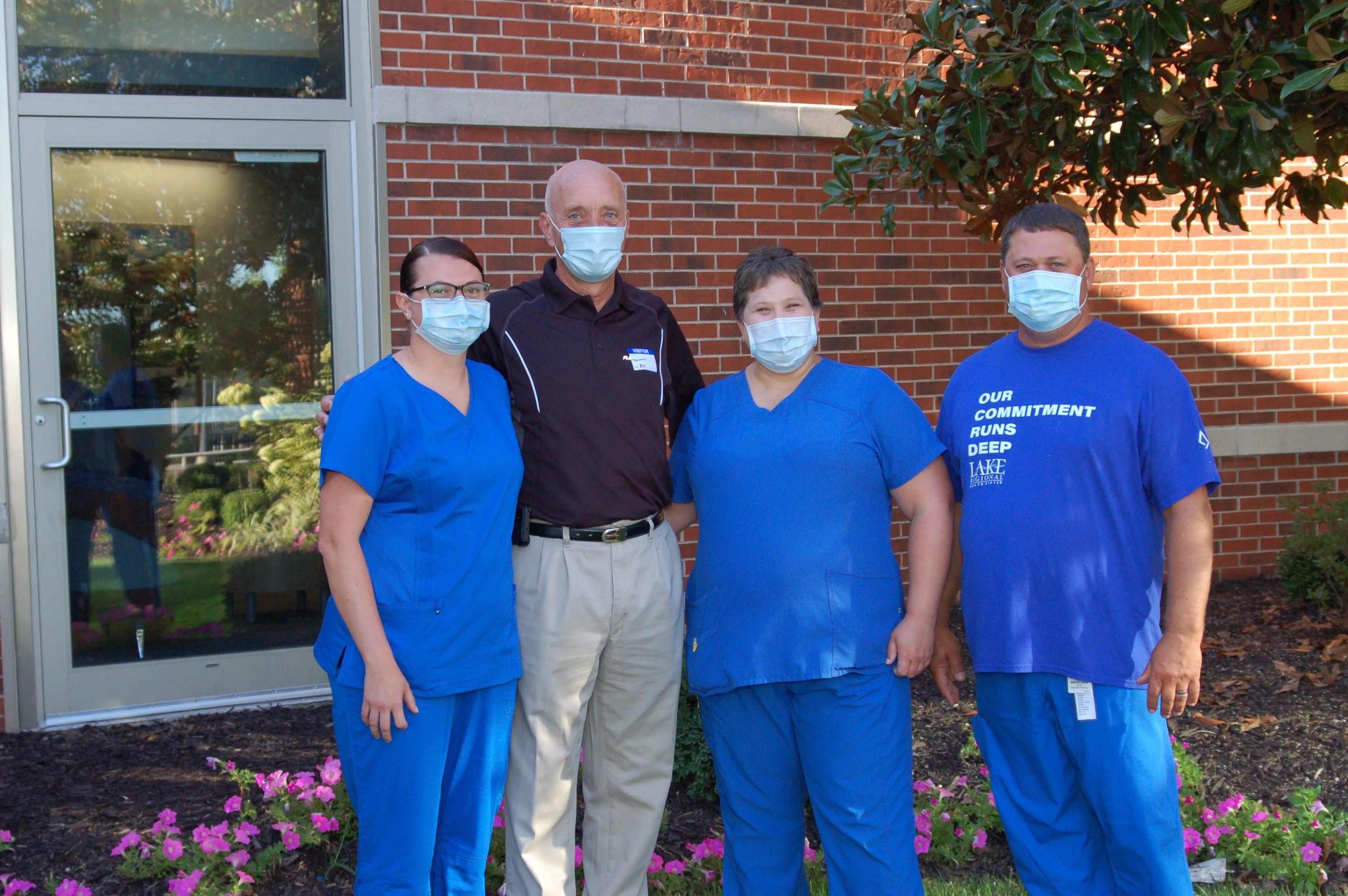 Jon Wiebe with members of his Lake Regional care team