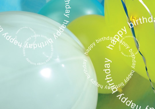 """Happy birthday"" overlaid on blue and green balloons"