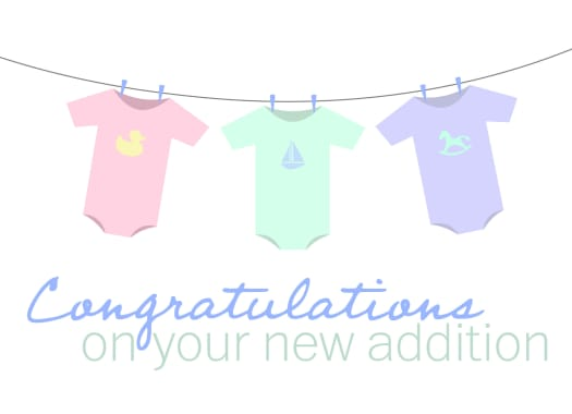 "A clothesline with baby onesies with the message ""Congratulations on your new addition"""