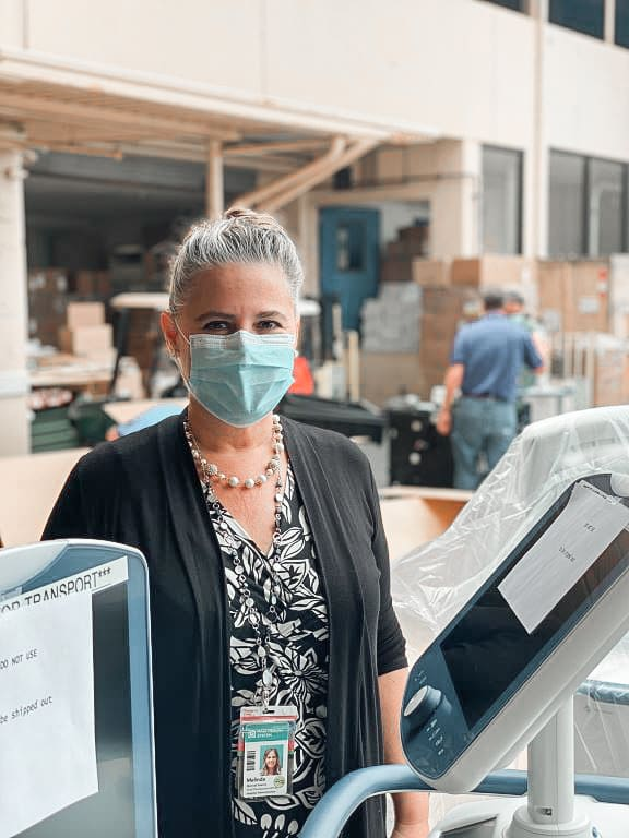 Maui Health Foundation Director Melinda Sweany helps to unpack new ventilators for Maui Memorial Medical Center.