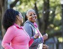 Two middle-aged women walking outside.