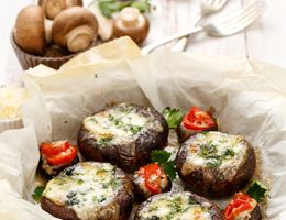 Stuffed mushrooms in a serving basket on a white tablecloth