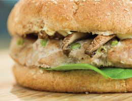 A turkey burger with mushrooms