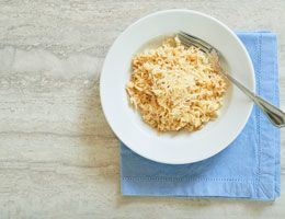 Parmesan rice and pasta pilaf in a bowl