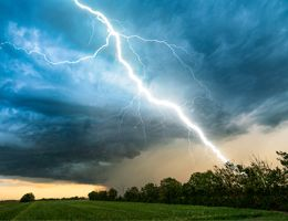 A stormy sky with a bolt of lightning.