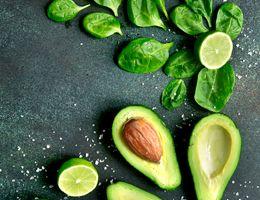 Half an avocado on a cutting board