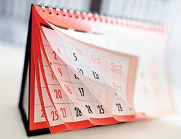 A calendar with its pages fanned out.