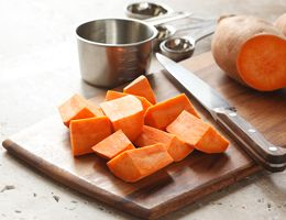 Cut up sweet potatoes.