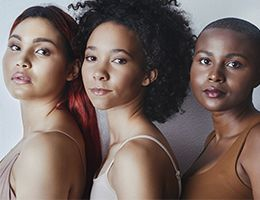 Several women of color with varying hair shades and styles.