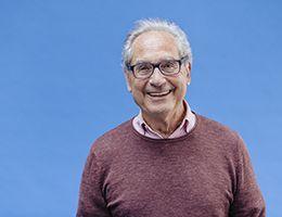 A smiling older man.