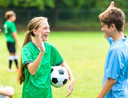 A group of teen or preteen soccer players.
