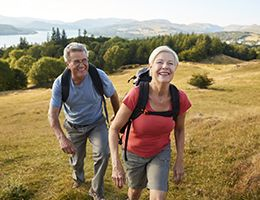 An aging couple on a hike.