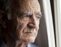 A close-up of a face of an older man.