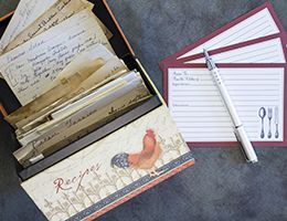 An open recipe box displays handwritten recipe cards.