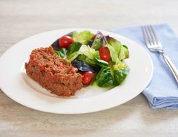Meatloaf on a plate with salad