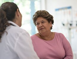 An older woman with a healthcare provider.