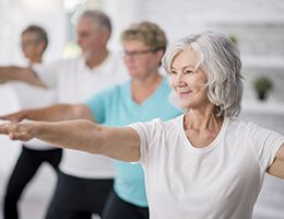A group of aging adults participating in a tai chi class.