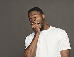A man yawning.