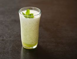 Minted honeydew cooler in a tall glass