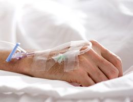 A hand hooked up to an IV.