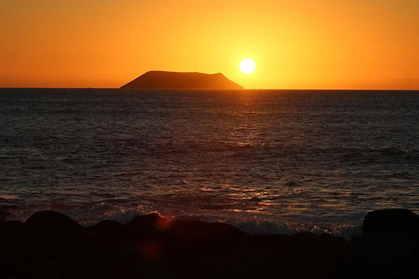 Petrel's 8-Day Itinerary A Day Seven - Sunset in the Galapagos Islands.