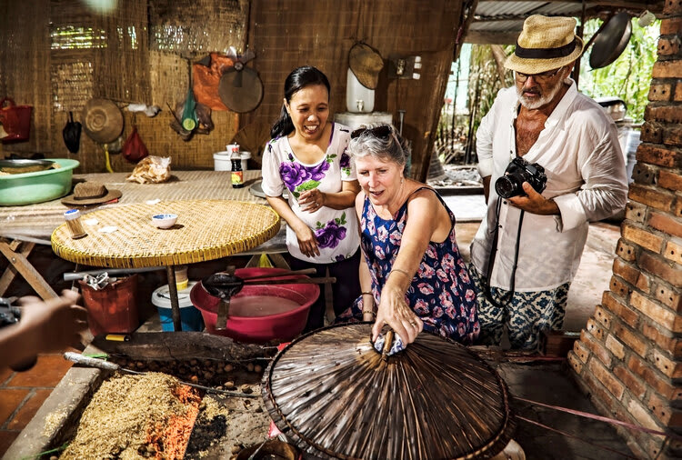 Mekong Navigator's 8-Day Upstream Itinerary Day Six - Mekong Rice Pancake