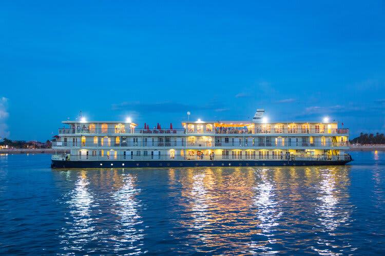 Mekong Navigator's 8-Day Downstream Itinerary Day Three - Boat at Dusk