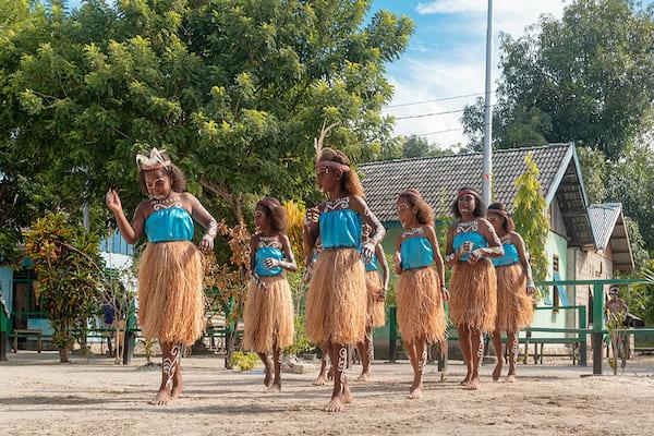 Aqua Blu's 13-Day Spice Island to Raja Ampat - Day Seven - Villagers Children Perfoming Dance