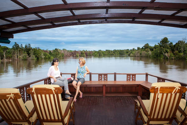 Rahai'i Pangun's Relaxing Orangutan & Dayak Village Downriver - Day Three - Guests Relaxing on Deck