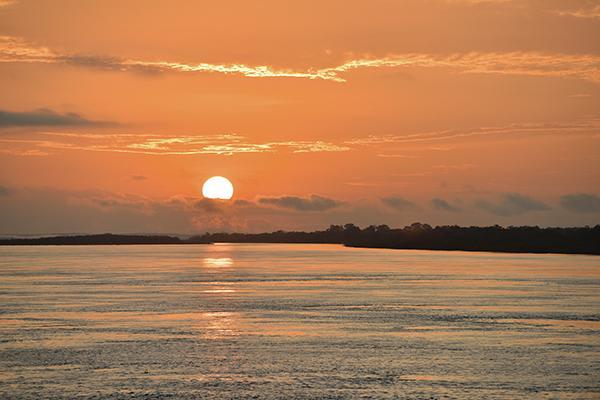 Amazon Odyssey's 5-Day Evasion Cruise Day Two - Orange sunset.