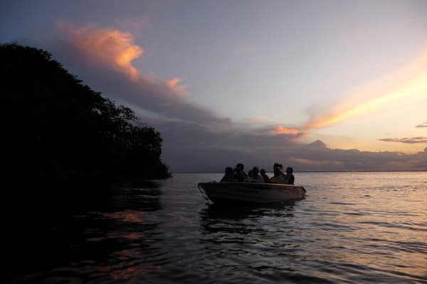 Amazon Dream's 7-Day New Years Cruise Itinerary Day Four - Sunset on the river.