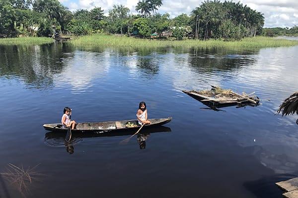 Amazon Dream's 10-Day Amazon & Tapajos Rivers Cruise Itinerary Day Nine - Natives canoeing.